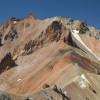 ... Билната част е разрушена и ерозирана, останали са назъбени скални грамади и тесни била ...